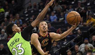 Cleveland Cavaliers' Dante Exum (1) shoots a layup against Minnesota Timberwolves' Jarrett Culver (23) during the second quarter of an NBA basketball game on Saturday, Dec. 28, 2019, in Minneapolis. (AP Photo/Hannah Foslien)