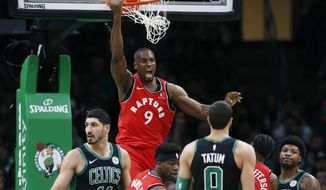 Toronto Raptors' Serge Ibaka (9) reacts after his dunk during the first half on an NBA basketball game against the Boston Celtics in Boston, Saturday, Dec. 28, 2019. (AP Photo/Michael Dwyer)
