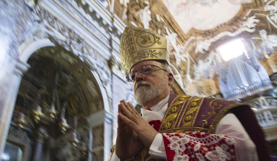 In this Sunday, March 10, 2013, file photo, U.S. Cardinal Sean Patrick O'Malley arrives to the Santa Maria alla Vittoria church in Rome to celebrate Mass. (AP Photo/Domenico Stinellis) ** FILE **