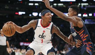 New York Knicks guard Frank Ntilikina (11) defends against Washington Wizards guard Bradley Beal (3) during the first half of an NBA basketball game in New York, Monday, Dec. 23, 2019. (AP Photo/Kathy Willens)