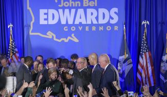 FILE - In this Nov. 16, 2019 file photo, Louisiana Gov. John Bel Edwards arrives to address supporters at his election night watch party in Baton Rouge, La. On Saturday, voters reelected Edwards to a second term, as he defeated Republican businessman Eddie Rispone. (AP Photo/Matthew Hinton, File)