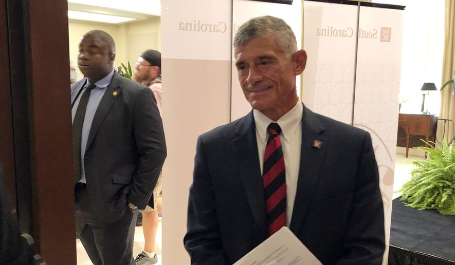 In this Monday, July 22, 2019, file photo, new University of South Carolina President Bob Caslen meets with alumni and others, in Columbia, S.C. (AP Photo/Jeffrey Collins) ** FILE **
