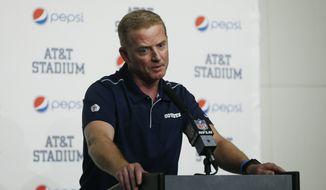 Dallas Cowboys head coach Jason Garrett takes part in a news conference following an NFL football game against the Washington Redskins in Arlington, Texas, Sunday, Dec. 15, 2019. (AP Photo/Ron Jenkins)