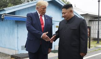 FILE - In this June 30, 2019 file photo, President Donald Trump meets with North Korean leader Kim Jong Un at the border village of Panmunjom in the Demilitarized Zone, South Korea. President Donald Trump starts the new year knee-deep in daunting foreign policy challenges at the same time he'll have to deal with a likely impeachment trial in the Senate and the demands of a reelection campaign. (AP Photo/Susan Walsh, File)