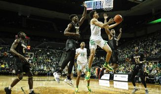 Oregon guard Will Richardson (0), shoots against Alabama State during the first half of an NCAA college basketball game Sunday, Dec. 29, 2019, in Eugene, Ore. (AP Photo/Thomas Boyd)