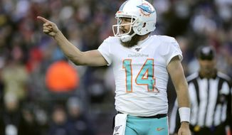 Miami Dolphins quarterback Ryan Fitzpatrick celebrates his winning touchdown pass to Mike Gesicki in the second half of an NFL football game against the New England Patriots, Sunday, Dec. 29, 2019, in Foxborough, Mass. (AP Photo/Charles Krupa)