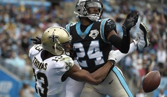 Carolina Panthers cornerback James Bradberry, right, breakas up a pass intended for New Orleans Saints wide receiver Michael Thomas (13) during the first half of an NFL football game in Charlotte, N.C., Sunday, Dec. 29, 2019. (AP Photo/Mike McCarn)