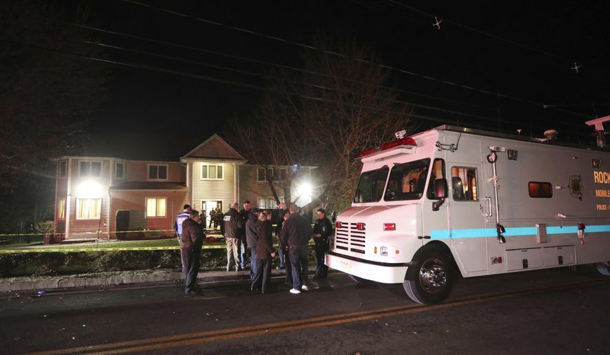 Police work the scene of a residence in Monsey, N.Y., early Sunday, Dec. 29, 2019, following a stabbing Saturday during a Hanukkah celebration. Authorities say that several people were stabbed north of New York City late Saturday night and a possible suspect has been located. The Orthodox Jewish Public Affairs Council for the Hudson Valley region tweeted reports that the stabbing took place at the house of a Hasidic rabbi while they were celebrating Hanukkah. (Seth Harrison/The Journal News via AP)