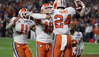 Clemson safety Nolan Turner (24) celebrates after his interception against Ohio State in the final minute of the Fiesta Bowl NCAA college football playoff semifinal Saturday, Dec. 28, 2019, in Glendale, Ariz. (AP Photo/Rick Scuteri) ** FILE **