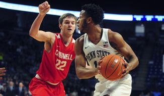 Penn State's Cornell's Josh Warren (22) pressures Penn State's Lamar Stevens (11) in first half action of an NCAA college basketball game, Sunday, Dec. 29, 2019, in State College, Pa. (AP Photo/Gary M. Baranec)