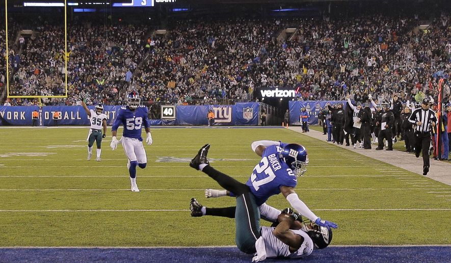 Philadelphia Eagles tight end Josh Perkins (81) scores a touchdown in front of New York Giants cornerback Deandre Baker (27) in the first half of an NFL football game, Sunday, Dec. 29, 2019, in East Rutherford, N.J. (AP Photo/Seth Wenig)