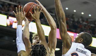Auburn forward Isaac Okoro (23) and Auburn forward Anfernee McLemore (24) block a shot by Lipscomb forward Parker Hazen (13) during the first half of an NCAA college basketball game Sunday, Dec. 29, 2019, in Auburn, Ala. (AP Photo/Julie Bennett)