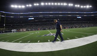 Dallas Cowboys head coach Jason Garrett walks the sideline during the second half of an NFL football game against the Washington Redskins in Arlington, Texas, Sunday, Dec. 15, 2019. (AP Photo/Ron Jenkins)
