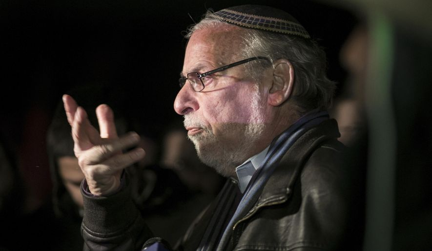 N.Y. state Assemblyman Dov Hikind speaks in Monsey, N.Y., Sunday, Dec. 29, 2019, following a stabbing late Saturday during a Hanukkah celebration. A man attacked the celebration at a rabbi's home north of New York City late Saturday, stabbing and wounding several people before fleeing in a vehicle, police said. (AP Photo/Allyse Pulliam)