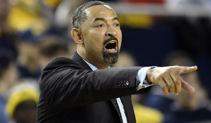 Michigan head coach Juwan Howard gives instructions to his team as they played against UMass-Lowell during the first half of an NCAA college basketball game, Sunday, Dec. 29, 2019, in Ann Arbor, Mich. (AP Photo/Jose Juarez)