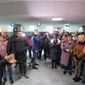 In this photo provided by the Ukrainian Presidential Press office, Ukrainian President Volodymyr Zelenskiy, left, speaks to relatives of Ukrainian prisoners waiting their arrival after being released after a prisoner exchange at Boryspil airport, outside Kyiv, Ukraine, Sunday, Dec. 29, 2019. Ukrainian forces and Russia-backed rebels in eastern Ukraine have exchanged 200 prisoners in a move aimed at ending their five-year war. The swap is part of an agreement brokered this month at a summit of the leaders of Ukraine, Russia, Germany and France. (Ukrainian Presidential Press Office via AP)