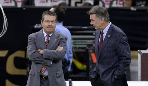 Washington Redskins owner Dan Snyder, left, and general manager Bruce Allen talk before an NFL football game against the New Orleans Saints in New Orleans, Monday, Oct. 8, 2018. (AP Photo/Bill Feig) **FILE**