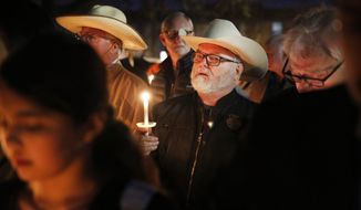 Stephen Willeford, who confronted and exchanged gunfire with the Sutherland Springs church shooter in 2017, joined church and community members outside West Freeway Church of Christ for a candlelight vigil Monday in White Settlement, Texas. A gunman shot and killed two people before an armed security officer returned fire, killing him during a service at the church on Sunday. (Associated Press/File)