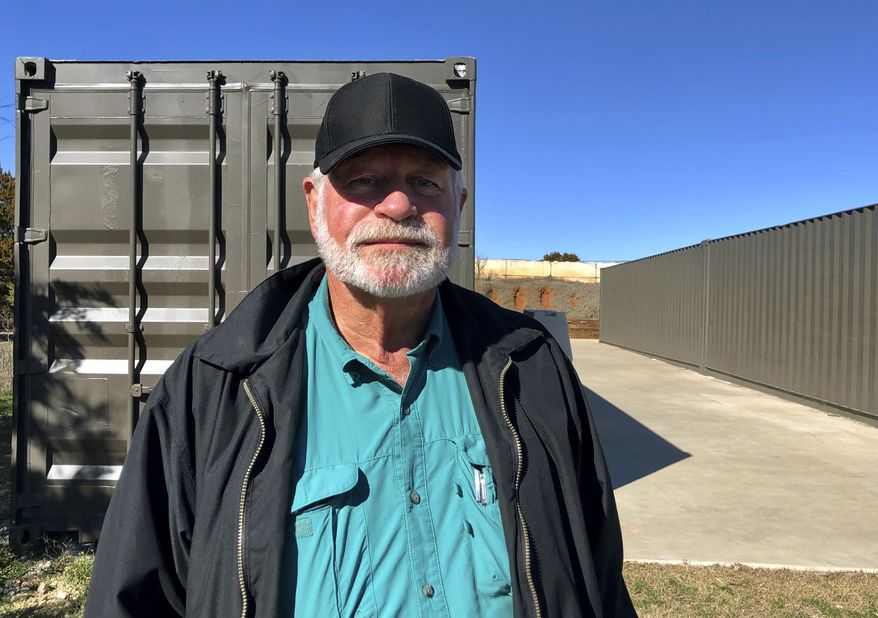 Jack Wilson, 71, poses for a photo at a firing range outside his home in Granbury, Texas, Monday, Dec. 30, 2019. Wilson trains the volunteer security team of the West Freeway Church of Christ, where a gunman shot two people Sunday before being shot by Wilson. (AP Photo/Jake Bleiberg)