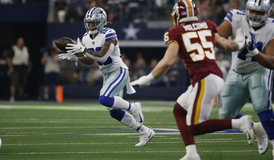 Dallas Cowboys running back Tony Pollard (20) makes a catch against the Washington Redskins during the first half of an NFL football game in Arlington, Texas, Sunday, Dec. 15, 2019. (AP Photo/Ron Jenkins)