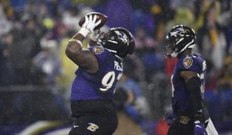 Baltimore Ravens defensive tackle Michael Pierce, left, celebrates with linebacker Tyus Bowser after recovering a fumble by Pittsburgh Steelers quarterback Devlin Hodges during the first half of an NFL football game, Sunday, Dec. 29, 2019, in Baltimore. (AP Photo/Gail Burton) ** FILE **