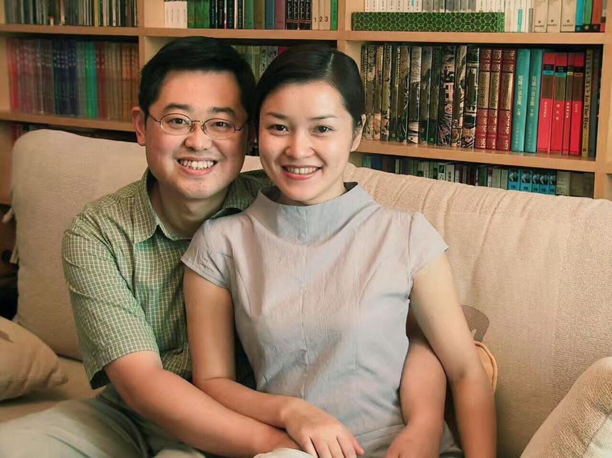 In this 2000 photo provided by ChinaAid, pastor Wang Yi, left, poses with his wife Jiang Rong at the study room of their home. China on Monday, Dec. 30, 2019, sentenced the prominent pastor who operated outside the Communist Party-recognized Protestant organization to nine years in prison. The People's Intermediate Court in the southwestern city of Chengdu said Wang Yi was also convicted of illegal business operations, fined and had his personal assets seized. (ChinaAid via AP)  **FILE**