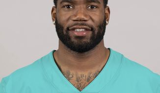 File-This is a 2019 photo of Xavien Howard of the Miami Dolphins NFL football team. Howard has been arrested on a domestic battery charge following an argument with his fiance. Davie police said in an arrest report that the woman was injured as the couple argued over the purchase of a purse. The report says Howard pushed her against a mirror in the hallway of their bedroom and let her go. She fell to the floor, landing on his crutches. (AP Photo/File)