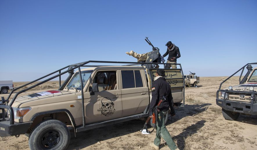 Paramilitary Popular Mobilization Forces and local tribal militias participate in the military operations of the Iraqi army Seventh Brigade, at the start of the eighth phase of the operation, in Anbar, Iraq, Sunday, Dec. 29, 2019. An Iraqi general said Sunday that security has been beefed up around the Ain al-Asad air base, a sprawling complex in the western Anbar desert that hosts U.S. forces, following a series of attacks. (AP Photo/Nasser Nasser)