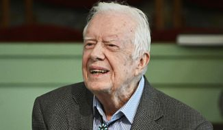 FILE - In this Nov. 3, 2019, file photo, former President Jimmy Carter teaches Sunday school at Maranatha Baptist Church in Plains, Ga. Carter publicly appeared at his Georgia church for the first time since undergoing brain surgery in November. The 95-year-old Carter and his wife of 40 years, Rosalynn, worshiped at the Maranatha Baptist Church in Plains on Sunday, Dec. 29, news outlets report. (AP Photo/John Amis, File)