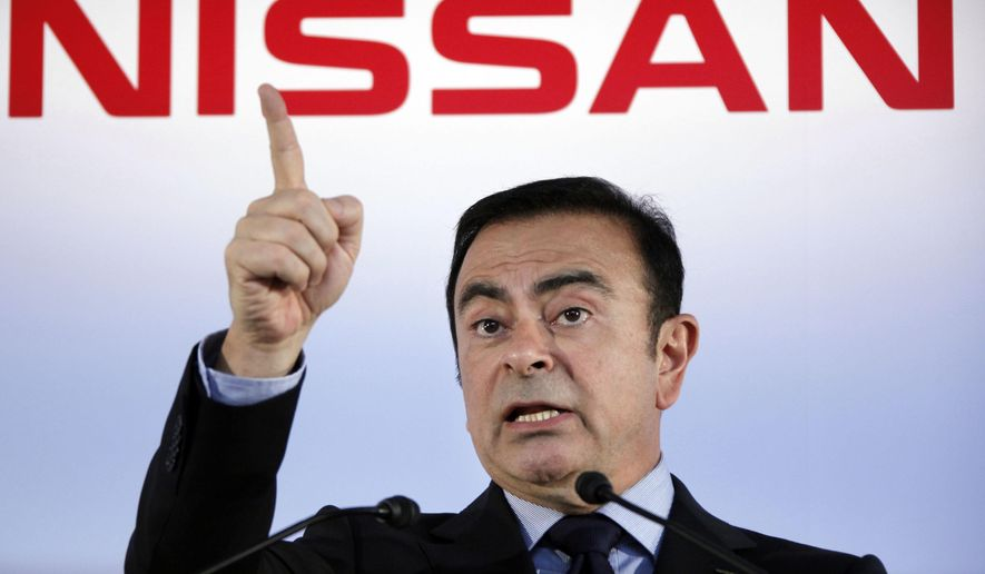 In this May 11, 2012, file photo, then Nissan Motor Co. President and CEO Carlos Ghosn speaks during a press conference in Yokohama, near Tokyo. A close friend says Monday, Dec. 30, 2019, that Ghosn, who is awaiting trial in Japan, has arrived in Beirut. It was not clear how Ghosn, who is of Lebanese origins, left Japan where he is under surveillance and is expected to face trial in April 2020. (AP Photo/Koji Sasahara, File)