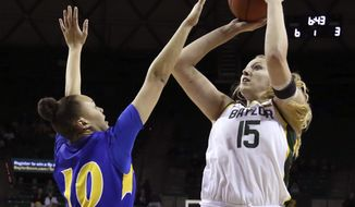 Baylor forward Lauren Cox, right, shoots over Morehead State forward Jaleesa Avery, left, in the first half of an NCAA college basketball game, Monday, Dec. 30, 2019, in Waco, Texas. (Rod Aydelotte/Waco Tribune Herald, via AP)