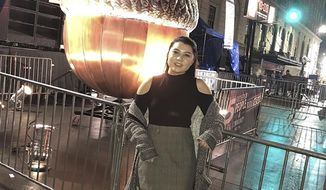 This photo provided by Allyson Cole shows Kaitlyn Kong at the First Night Raleigh celebration in Raleigh, N.C., on Dec. 31, 2018. Kong suffered a gunshot wound after someone fired a gun into the air to celebrate the new year.Although rare, people being shot by celebratory gunfire on New Year's Eve and other holidays like the Fourth of July does happen, prompting law enforcement authorities to caution people that bullets fired into the air can endanger people's lives. (Allyson Cole via AP)
