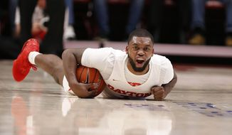 Dayton guard Trey Landers shouts as he gets control of the basketball during the first half of an NCAA college basketball game against North Florida, Monday Dec. 30, 2019, in Dayton. (AP Photo/Gary Landers)