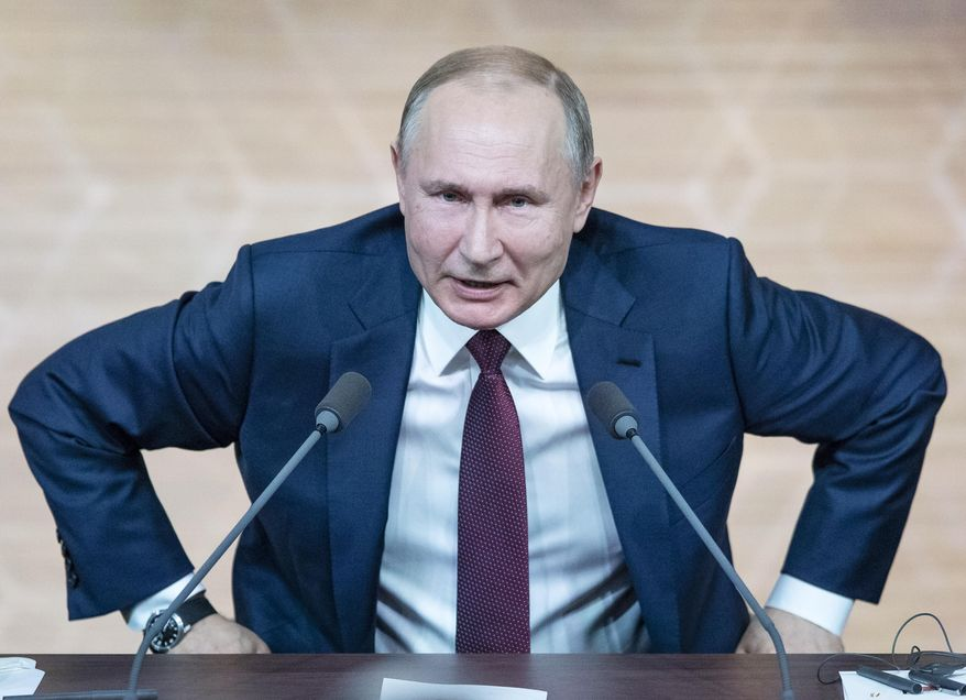 Russian President Vladimir Putin, who spent his formative years in the KGB and later served as director of Russia's FSB security police, wanted the world to know he was seeking to influence U.S. public opinion. (Associated Press/File)