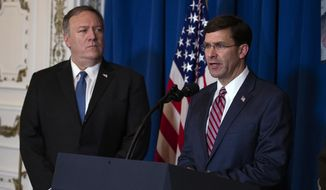 Secretary of State Mike Pompeo, left, listens as Secretary of Defense Mark Esper delivers a statement on Iraq and Syria at President Donald Trump's Mar-a-Lago property, Sunday, Dec. 29, 2019, in Palm Beach, Fla. (AP Photo/ Evan Vucci) ** FILE **