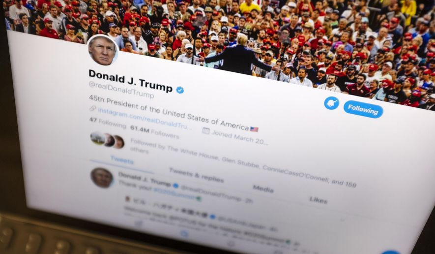 In this June 27, 2019, file photo, President Donald Trump's Twitter feed is photographed on an Apple iPad in New York. (AP Photo/J. David Ake, File)