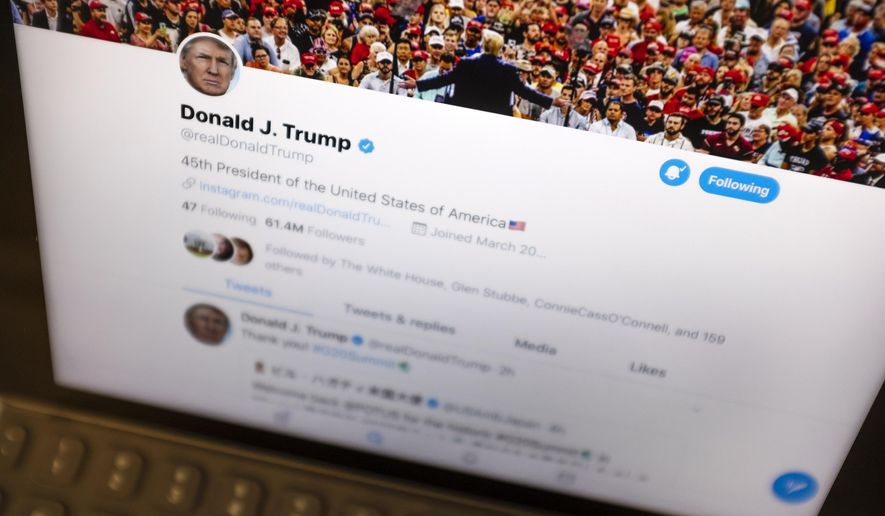 FILE - This June 27, 2019, file photo President Donald Trump's Twitter feed is photographed on an Apple iPad in New York. Trump's retweet of a post with the alleged name of the impeachment whistleblower shows how social media gives everyday Americans a direct line to the president, even if the identity of the tweeter is unknown. (AP Photo/J. David Ake, File)