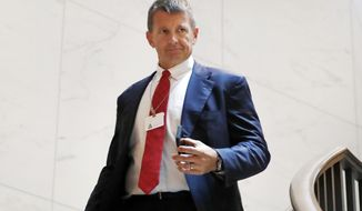 FILE - In this Nov. 30, 2017 file photo, Blackwater founder Erik Prince arrives for a closed meeting with members of the House Intelligence Committee on Capitol Hill in Washington. Prince, a major Republican donor and founder of controversial security firm Blackwater, has been referred to the U.S. Treasury Department for possible sanctions violations tied to his recent trip to Venezuela for a meeting with a top aide of President Nicolas Maduro, two senior U.S. officials said. (AP Photo/Jacquelyn Martin)