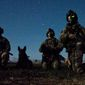 Rangers from Headquarters and Headquarters Company, 3rd Battalion, 75th Ranger Regiment and a multi-purpose canine pause during a nighttime combat mission in Afghanistan. Courtesy U.S. Army.