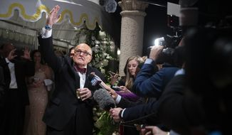 Former New York Mayor Rudy Giuliani, an attorney for President Donald Trump, speaks to reporters as he arrives for a New Year's Eve party hosted by President Donald Trump at his Mar-a-Lago property, Tuesday, Dec. 31, 2019, in Palm Beach, Fla. (AP Photo/ Evan Vucci)