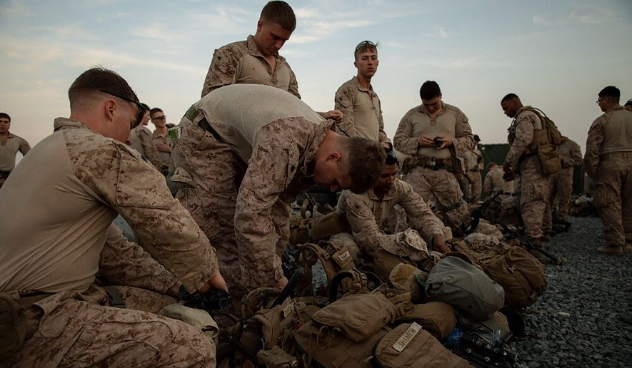 Marines in Kuwait were dispatched Tuesday to the U.S. Embassy compound in Iraq after a protest led by members of the Iraqi Shiite militia Kataeb Hezbollah turned violent. (Associated Press)