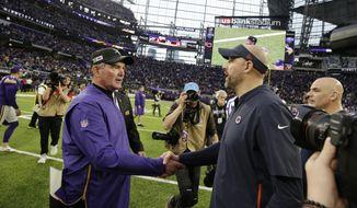 Minnesota Vikings head coach Mike Zimmer, left, greets Chicago Bears head coach Matt Nagy after an NFL football game, Sunday, Dec. 29, 2019, in Minneapolis. The Bears won 21-19. (AP Photo/Andy Clayton-King)
