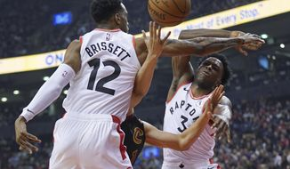 Toronto Raptors' Oshae Brissett (12) and OG Anunoby (3) defend against Cleveland Cavaliers' Dante Exum (1) during the first half of an NBA basketball game Tuesday, Dec. 31, 2019, in Toronto. (Hans Deryk/The Canadian Press via AP)