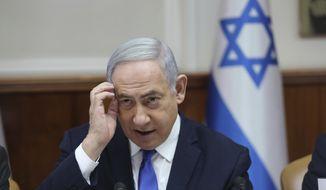 Israeli Prime Minister Benjamin Netanyahu attends the weekly cabinet meeting at his office in Jerusalem, Israel, Sunday, Dec. 29, 2019. (Abir Sultan /Pool photo via AP)
