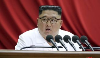 """In this Monday, Dec. 30, 2019, photo provided by the North Korean government, North Korean leader Kim Jong Un speaks during a Workers' Party meeting in Pyongyang, North Korea. Independent journalists were not given access to cover the event depicted in this image distributed by the North Korean government. The content of this image is as provided and cannot be independently verified. Korean language watermark on image as provided by source reads: """"KCNA"""" which is the abbreviation for Korean Central News Agency. (Korean Central News Agency/Korea News Service via AP)"""