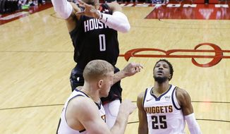 Houston Rockets guard Russell Westbrook (0) drives to the basket as Denver Nuggets forward Mason Plumlee, bottom, defends during the first half of an NBA basketball game, Tuesday, Dec. 31, 2019, in Houston. (AP Photo/Eric Christian Smith)