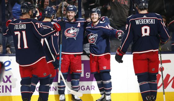 Columbus Blue Jackets' Boone Jenner, center, celebrates his goal against the Florida Panthers during the second period of an NHL hockey game Tuesday, Dec. 31, 2019, in Columbus, Ohio. (AP Photo/Jay LaPrete)