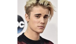 """FILE - This Nov. 22, 2015 file photo shows Justin Bieber at the American Music Awards in Los Angeles. Bieber is a launching a docu-series about creating his new album on YouTube, the platform the singer originally got his start in music over a decade ago. YouTube announced Tuesday that """"Justin Bieber: Seasons"""" will debut on Jan. 27 and the 10-episode series will follow the pop star while he records his first new album since 2015. (AP Photo by Jordan Strauss/Invision/AP)"""