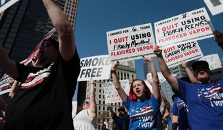 "Demonstrators chanted ""I Vape, I Vote"" during a rally in October at the Ohio Statehouse in Columbus. Four out of five electronic cigarette users, or ""vapers,"" said they are likely to decide how they will vote this year based on candidates' positions on vaping. (Associated Press/File)"