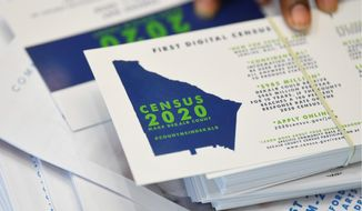 """Census forms will be sent out in March, and the official census day is scheduled for April 1. Census Bureau officials say they have ways of dealing with partial answers, such as follow-up calls or visits and using other records or """"statistical methodology."""" (Associated Press/File)"""